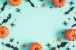 canvas print picture - Halloween decorations on blue background. Halloween concept. Flat lay, top view, copy space