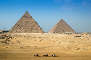 Camel rides around the Giza pyramid complex, Cairo, Egypt