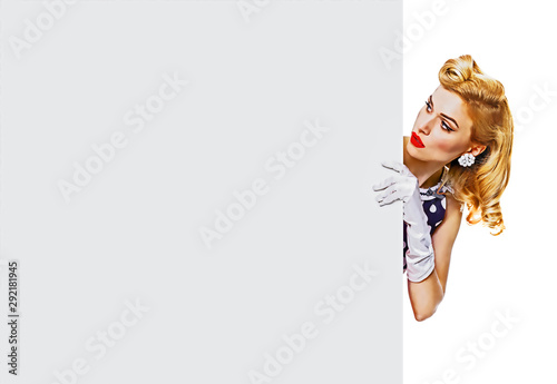 Portrait of beautiful blond girl in pin up style, showing blank signboard with copy space area for some text, slogan or advertising, isolated over white - 292181945