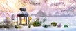 Leinwanddruck Bild - Christmas Lantern On Snow With Fir Branch in the Sunlight