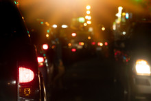 Abstract Bokeh Lights, Headlights Of Moving Cars Urban Traffic. With Car Open Brake Light.
