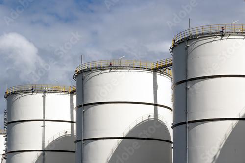 Row of oil storage tanks. Slika na platnu