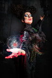 Scary witch conjuring magic