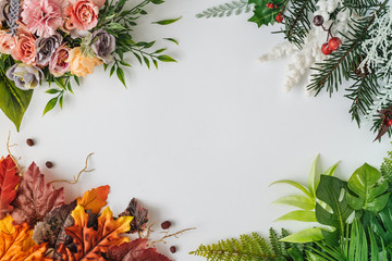 Creative season layout of colorful summer, spring, autumn and winter leaves and flowers. Nature mockup background. Seasonal concept. Flat lay