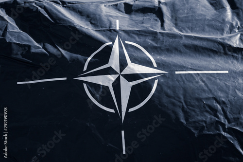 Photo  Dark blue canvas with symbol of NATO ( North Atlantic Treaty Organization )