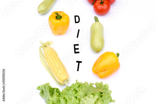 Flat lay on an isolated white background with vegetables and the inscription diet Obraz na płótnie