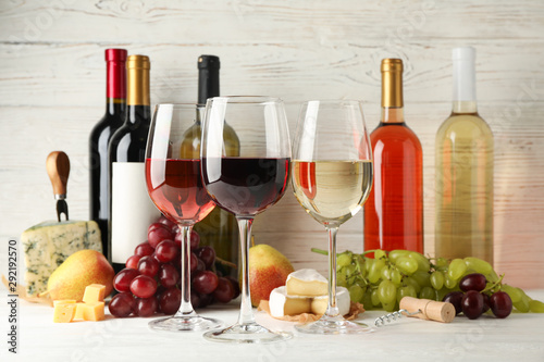 Bar Fruits, cheese, bottles and glasses with different wine on white background, space for text