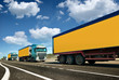 Yellow truck is on highway - business, commercial, cargo transportation concept, clear and blank space on the side view