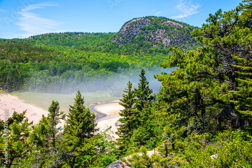 Photo Fog over Sand Beach with Beehive Trail Cliffs in the background, Acadia National