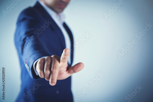 Photo business  man finger touching in screen