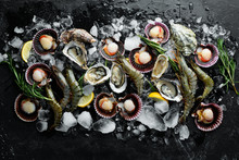 Seafood. Oysters, Scallops, Shrimp. Top View. On A Black Background. Free Copy Space.