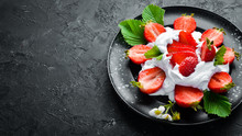 Strawberry With Cream In A Pla...