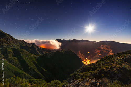 View of mountain peak against starry sky at night sky, Moon, Madeira Îsland, Portugal.