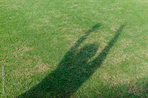 Photo The shadow of player trow the soccer football on the artificial grass soccer field