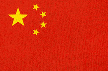 Red Grunge Chinese Flag With Yellow Stars.