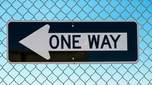 One Way Sign On Wire Fence