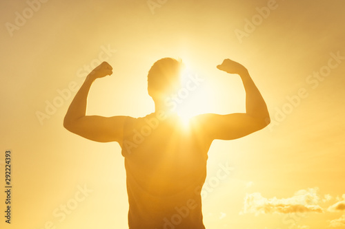 Strong man flexing in the sunshine Canvas Print