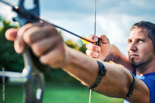 Leinwand Poster Archer. Sportsman practicing archery. Sport, recreation concept