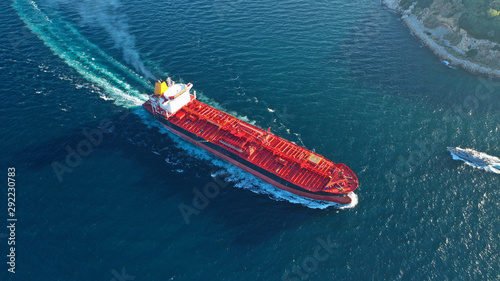 Obraz na plátně  Aerial top down photo of industrial oil and fuel tanker cruising open ocean sea