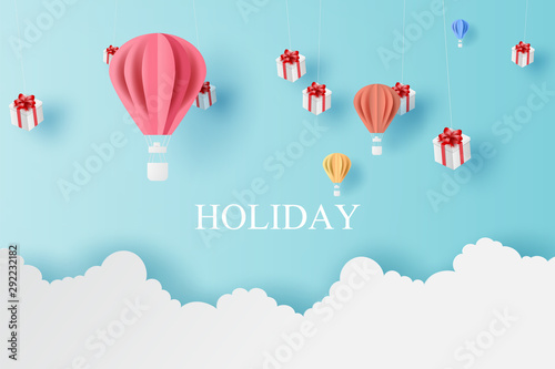 Fényképezés  Landscape of balloons colorful fly and Mobile hanging gift box with Cloud on blue sky