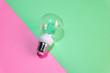 Leinwanddruck Bild - Light bulb ( lightbulb) on a colored background. Minimal concept.