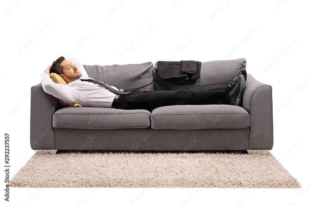 Fototapeta Man resting on a sofa after work