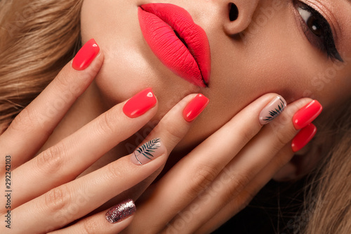 Obraz Beautiful young woman with bright makeup and neon pink nails. Beauty face. Photo taken in the studio - fototapety do salonu