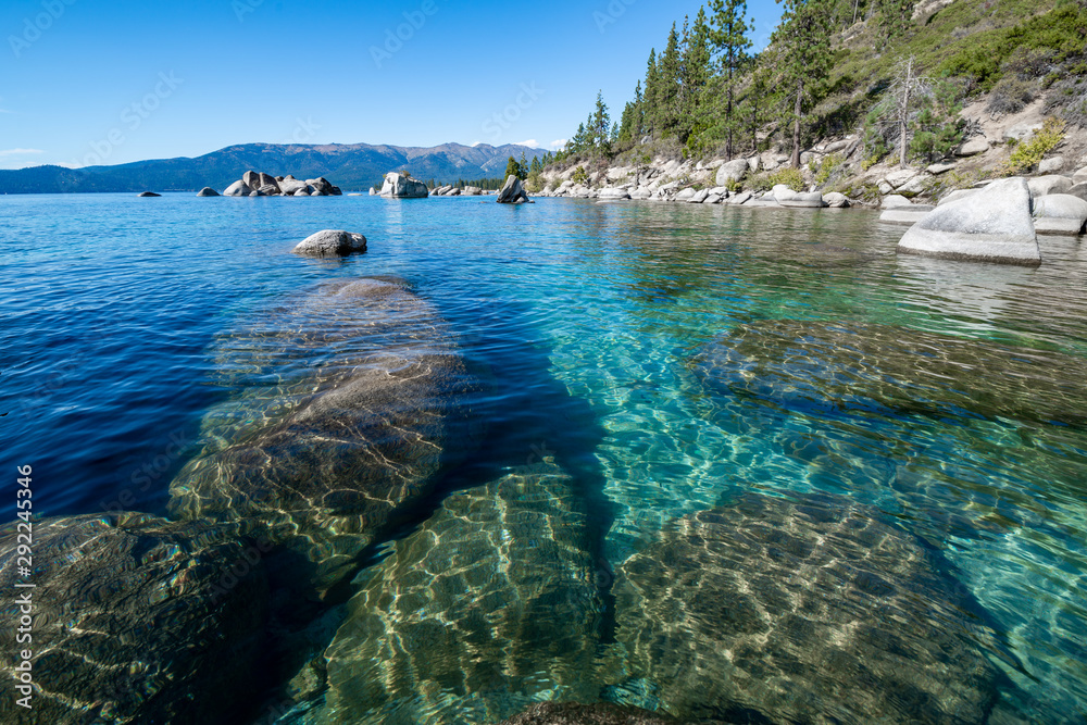 Fototapety, obrazy: USA, Nevada, Washoe County, Lake Tahoe. Granite boulders under the clear blue to emerald waters along the eastern shore.