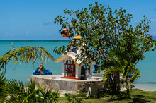 Hindu Shrine Alongside The Anse La Raie Beach On The Tropical Island Of Mauritius
