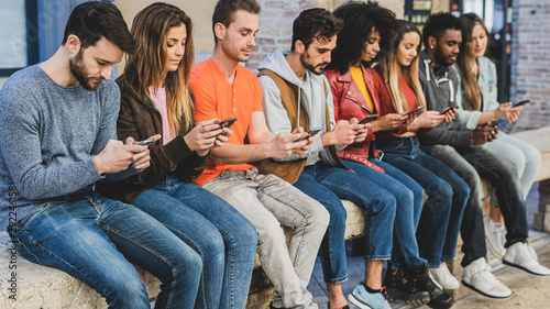 Foto  Youth addicted for the smartphone and social media networks