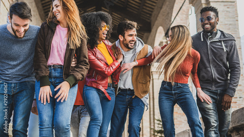 obraz PCV Multiracial group of millennials having fun walking in the city in the morning.