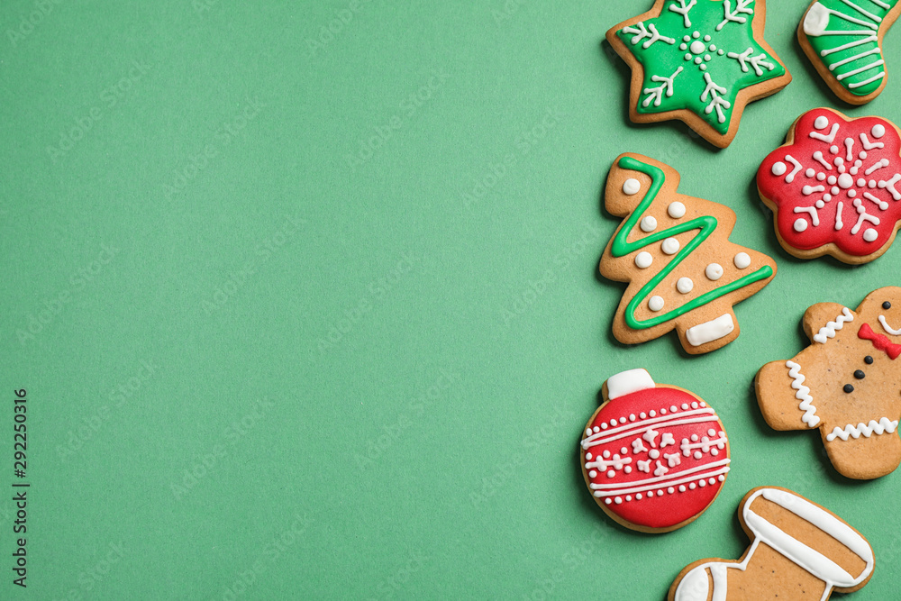 Fototapeta Flat lay composition with tasty homemade Christmas cookies on green background, space for text