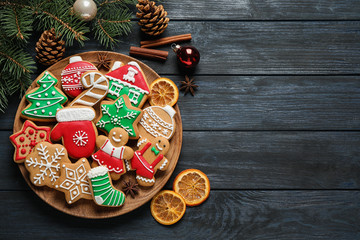 Flat lay composition with tasty homemade Christmas cookies on dark blue wooden table, space for text