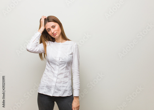 Young russian girl worried and overwhelmed Wallpaper Mural