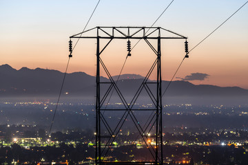 Predawn view of electric power lines entering the San Fernando Valley and Los Angeles, California.  The San Gabriel Mountains are in background.