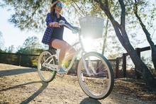 Female On Cruiser Bike In Park