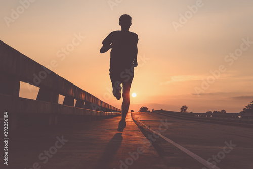 Leinwand Poster  Athlete runner feet running on road, Jogging at outdoors