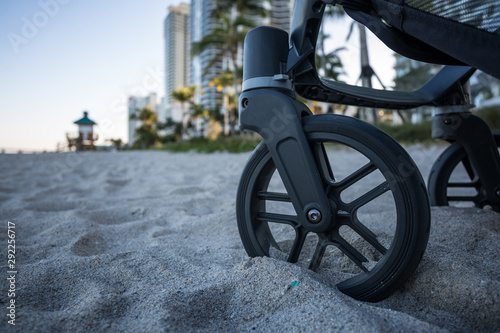 Printed kitchen splashbacks Bicycle Baby stroller on the beach.