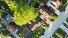 Aerial View Of Residential Houses At Summer. American Neighborhood, Suburb.  Real Estate, Drone Shots, Sunset, Sunlight, From Above.
