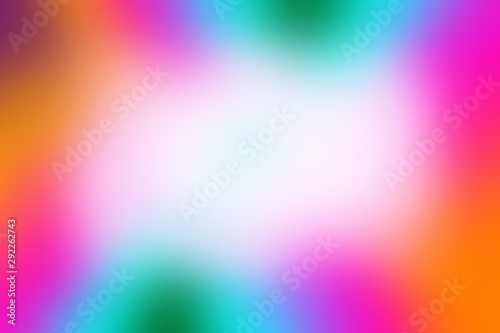 Photo  A blurry rainbow colored border background.