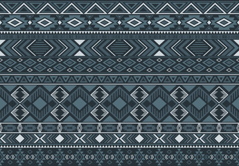 Ikat pattern tribal ethnic motifs geometric seamless vector background. Rich indian tribal motifs clothing fabric textile print traditional design with triangle and rhombus shapes.