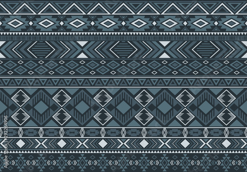 Foto auf Leinwand Boho-Stil Ikat pattern tribal ethnic motifs geometric seamless vector background. Rich indian tribal motifs clothing fabric textile print traditional design with triangle and rhombus shapes.