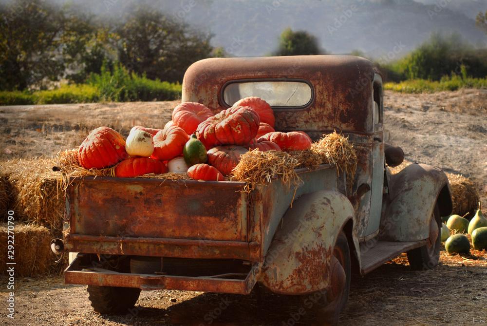 Old rusty truck full of fall pumpkins