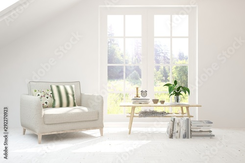 Fototapeta  Mock up of stylish room in white color with armchair and green landscape in window