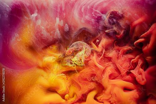 Fotografija  Smoke background. Enchanted air. Yellow red paint mix.
