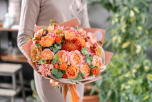 Bouquet Peach And Orange Color. Beautiful Hydrangea Flowers In A Vase On A Table . Decoration Of Home. Wallpaper And Background.