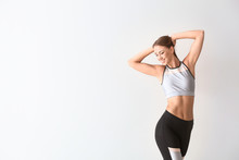 Beautiful Sporty Woman On Light Background. Weight Loss Concept