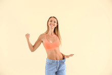 Happy Young Woman In Loose Jea...
