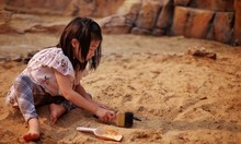 A Young Asian Girl Playing In ...