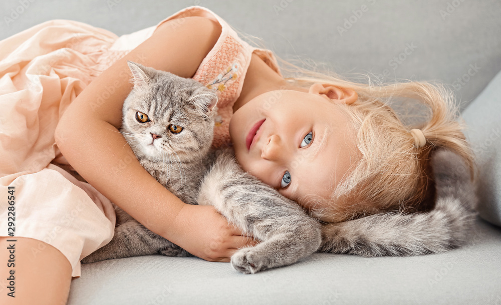 Fototapety, obrazy: Little girl with cute cat at home